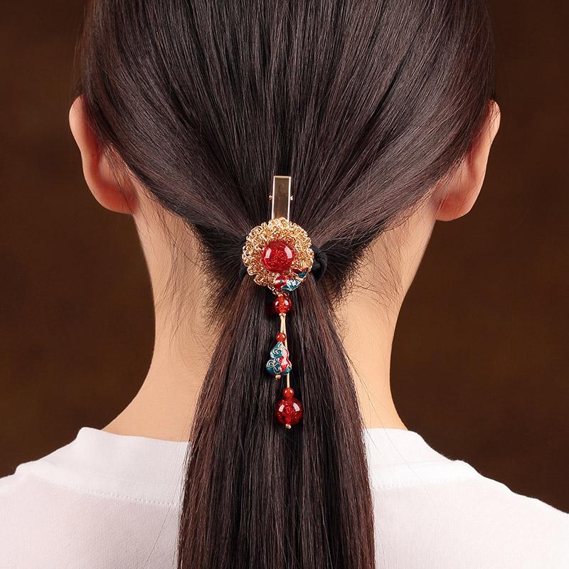 惊艳鱼悦发夹:一颗耀眼的红珠